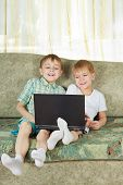 Two Laughing Boys With Notebook