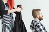 Hairdresser, Stylist And Barber Shop Concept - Young Woman Hairstylist Is Going To Cut A Man poster
