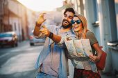 Summer Holidays, Dating And Tourism Concept. Smiling Happy Couple With Map In The City poster