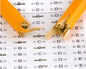 stock photo of self assessment  - a broken pencil sitting on a test paper - JPG
