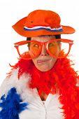 Dutch woman cross eyed dressed in orange with big sunglasses as a soccer fan