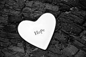 image of heartwarming  - A pure white heart on a charcoal type background - JPG