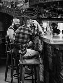 Friendship And Leisure. Friends Relaxing In Pub. Order Drinks At Bar Counter. Hipster Brutal Bearded poster