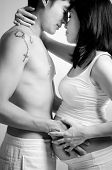 B&W Asian couple, 8 months pregnant women with husband standing