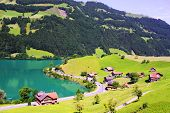 Beautiful Switzerland landscape with houses, lake and mountain