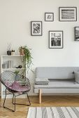 Stylish Black Metal Chair In Classy White Living Room Interior With Tenement House poster