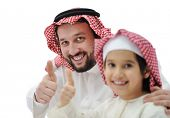 Arabian father and son with thumb up