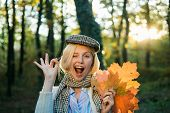 Happy Autumn Girl Winking. Autumn Girl Wearing In Autumn Clothes And Looks Very Sensually. Girl Play poster