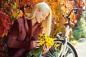 Woman With Bicycle Autumn Garden. Weekend Activity. Active Leisure And Lifestyle. Girl Ride Bicycle  poster