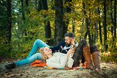 Romantic Picnic Forest. Couple In Love Tourists Relaxing On Picnic Blanket. Romantic Date In Nature. poster