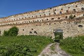 Ancient Wall Against The Blue Sky. Stare Selo Castle. Fortress In Stare Selo, Lviv Region. Ukraine.  poster