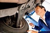 Mechanic working under a car at a repair shop