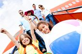 Happy kids traveling by airplane for their vacations