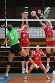 KAPOSVAR, HUNGARY - FEBRUARY 3: Zsofia Harmath (red 3) in action at the Hungarian Championship volle