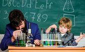 Touching Lives Forever. Father And Son At School. Teacher Man With Little Boy. School Lab Equipment. poster
