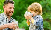 Feeding Son Natural Foods. Stage Of Development. Healthy Food. Dad And Boy Eat And Feed Each Other O poster
