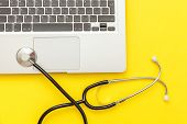 Stethoscope Keyboard Laptop Computer Isolated On Yellow Background. Modern Medical Information Techn poster
