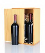 A gift box of cabernet sauvignon wine bottles isolated on white with reflection.