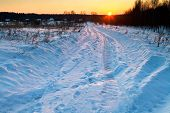 Sunset Under Snow Country Road