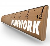 The word Homework on a wooden ruler symbolizing a lesson or assignment for school or educational tra