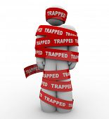 A person is wrapped in red tape with the word Trapped to symbolize being tied up, trangled or restri