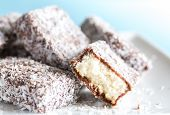 stock photo of sponge-cake  - Lamingon sponge cakes covered in chocolate and coconut