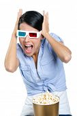 Putting hands on the head girl watching 3D movie, isolated on white