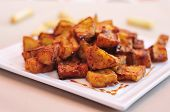 closeup of a plate with spanish berenjenas con miel de cana, fried eggplants with molasses, served a