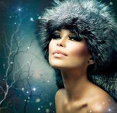 Winter Woman Portrait. Beauty Model Girl. Fur Fashion. Beautiful Girl in Fur Hat.