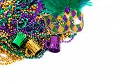 Assorted colored Mardi gras beads on a white background with copy space