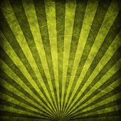 Green grunge sunbeams background or texture