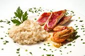 image of mullet  - white dish with rice with red mullet and seafood - JPG