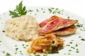 picture of mullet  - a white dish with rice with red mullet and seafood - JPG