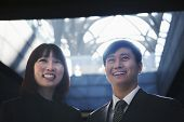 Two business people smiling together, portrait, Beijing