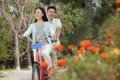 Couple riding tandem bicycle in Beijing