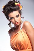 closeup portrait of a young fashion woman looking into the camera sensually. on gray background