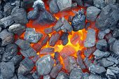 stock photo of furnace  - Red hot coal smouldering in blacksmith furnace - JPG