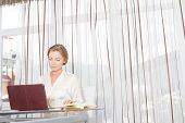 portrait of young beautiful business woman working with laptop in office