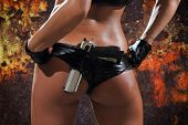 stock photo of projectile  - Sexy woman with gun over grunge background - JPG