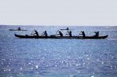 Women Paddling An Outrigger Canoe