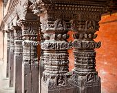 Carved wooden pillars on Mani Keshar Chowk at Durbar Sqaure in Patan, Lalitpur city,  Nepal.