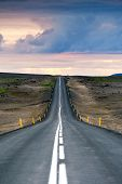 Iceland, Husavik, road 87. Ondulated and empty road in the sub-artic icelandic landscape. Travel, exploration, solitude.