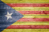 catalan pro-independence flag on wood texture background