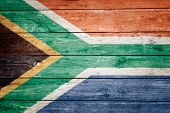south african flag on wood texture background