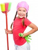 stock photo of broom  - Young girl is posing as a cleaning maid and holding broom - JPG