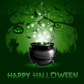 Halloween night background with with magic potion in a cauldron
