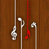 Hanging colorful musical notes on wooden background,  can be use as poster, banner for flyer for mus