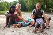Multicultural Family On The Beach