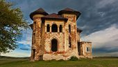 Old abandoned haunted house and sky in Transylvania with clouds.Abandoned mansion in ruins