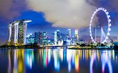 image of highrises  - Singapore skyline at night - JPG